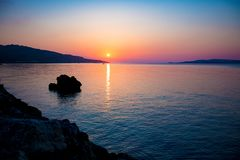 Panorama of sunset or sunrise on the calm sea.  stock photos
