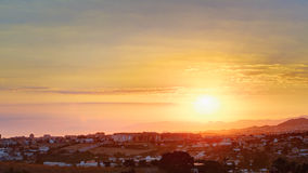 Panorama of Sunset Sunrise Over Mountain And Cityscape In Spain. Stock Photography