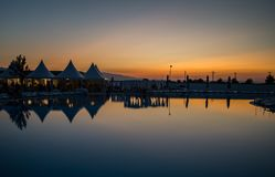 Panorama sunset water reflection view. Panorama view on sunset water reflection with tents Stock Photo