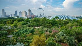 Singapore - october 16, 2018: panorama of supertrees of gardens by the bay, the singapore flyer and skyscrapers stock photo