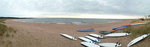Panorama with surfboards at Ristna beach Stock Photography