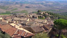 Panorama of the surroundings of Montepulciano on a sunny september day. Tuscany, Italy. Panorama of the surroundings of Montepulciano on a sunny september day stock footage