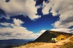 Panorama SUV on beautiful mountain landscape background Stock Photo