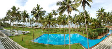 The panorama of swimming pool and beach Royalty Free Stock Images