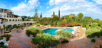 The panorama of swimming pool at luxury hotel Royalty Free Stock Photography