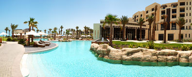 The panorama of swimming pool at the luxury hotel Stock Images