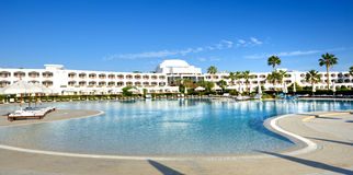The panorama of swimming pool at luxury hotel Royalty Free Stock Photos