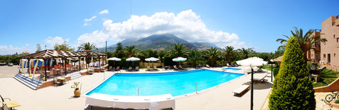 The panorama of swimming pool near luxury hotel Royalty Free Stock Image