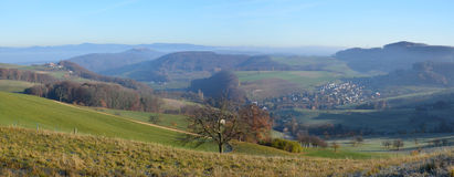 Panorama of Swiss hills with town Wintersingen. Royalty Free Stock Images
