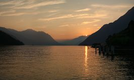 PANORAMA OF SWISS MOUNTAINS LAKE SUNSET, SWITZERLAND Royalty Free Stock Images