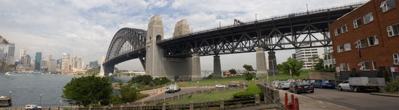 Panorama of Sydney Bridge. A true wide panorama of the world-famous Sydney Harbour Bridge, taken from the edge of Sydney Harbour. Taken from the east side of the Royalty Free Stock Images