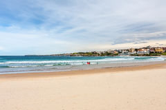 Panorama of Sydney harbor to the beach and people with surfing. Royalty Free Stock Image