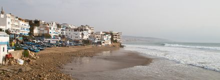 Panorama in taghazout with wave breaking at Panoramas surf spot Royalty Free Stock Photography