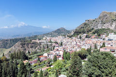 Panorama Taormina with southward view smoking Etna volcano, Sicily, Italy Stock Photos