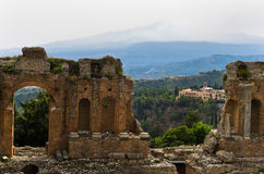 Panorama of Taromina from ancient greek theater, mount Etna in background, Sicily Royalty Free Stock Image