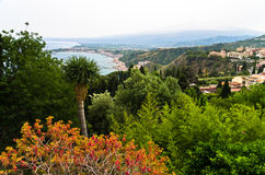 Panorama of Taromina bay from botanical garden, mount Etna in background, Sicily Stock Images