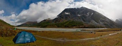 Panorama with tent and mountain Stock Photos