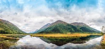 Panorama of Tern Lake on the Kenai Peninsula in Alaska with Mountain Reflections stock photo