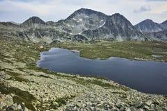 Panorama of Tevno Lake and Kamenitsa peak, Pirin mountain, Bulgaria Stock Image
