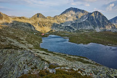 Panorama of Tevno Lake and Kamenitsa peak from Valyavishki chukar, Pirin mountain, Bulgaria Stock Image