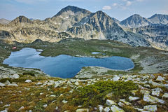 Panorama of Tevno Lake and Kamenitsa and The Tooth peak, Pirin mountain, Bulgaria Royalty Free Stock Photography