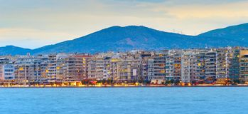 Thessaloniki waterfront panoramic view, Greece. Panorama of Thessaloniki at twilight with sea in the foreground. Greece royalty free stock images