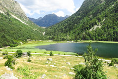 Panorama to Aiguestortes National Park, Catalan Pyrenees, Spain. Llebreta pond. Panorama to Aiguestortes National Park in the Catalan Pyrenees, Spain Stock Images