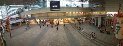 Panorama of Toa Payoh central hub. Big hall with TV screen next to HDB Hub building and bus and MRT interchange at Toa Payoh central Royalty Free Stock Images