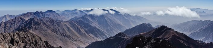 Panorama of Toubkal and other highest mountain peaks of High Atlas mountains in Toubkal national park, Morocco Stock Photography