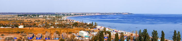Panorama of a tourist town on shore of the sea Stock Images