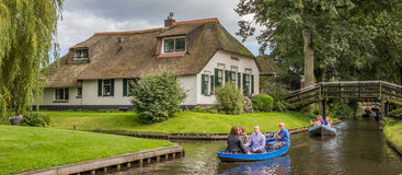 Panorama of tourists in an electric boat in the canals of Gietho Stock Image