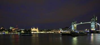 Panorama of Tower Bridge illuminated at night - London Stock Photos