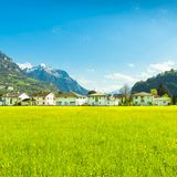 Small towns in Europe. Brunnen. Switzerland. Panorama of the town of Brunnen.  Alpine meadows with luscious bright grass. Travel to Europe Stock Images