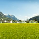 Small towns in Europe. Brunnen. Switzerland. Panorama of the town of Brunnen. Traditional Alpine meadows with luscious bright grass. Travel to Europe Stock Photo