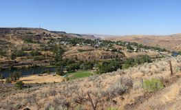 A panorama of the town of Mopin OR. A panoramic view of the town of Mopin Oregon before entering the town on the surrounding valleys Royalty Free Stock Images