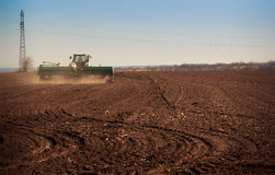 Panorama of tractor sowing in field Stock Images