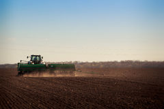 Panorama of tractor sowing in field Royalty Free Stock Photography
