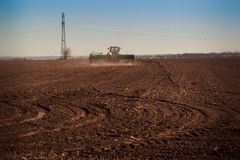 Panorama of tractor sowing in field Royalty Free Stock Image