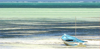Panorama of a traditional boat on turquoise beach Stock Photos