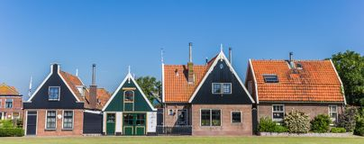 Panorama of traditional dutch houses in Oudeschild. Holland Royalty Free Stock Photography