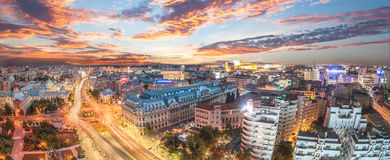 Panorama of traffic lights in the center of the capital city of Romania. Center of Bucharest at sunset. Romanian Parliament and University square Royalty Free Stock Image