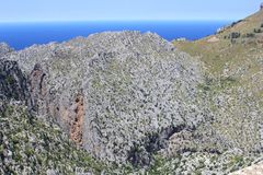 Panorama of Tramuntana mountains along the sea, Mallorca, Spain. Tramuntana mountains at Mallorca (Majorca), Spain. These mountains belong to the Unesco World Stock Photo