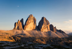 Panorama of Tre Cime at sunny sunset Stock Images