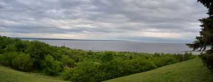 Panorama with trees and river in cloudy summer day Royalty Free Stock Photography