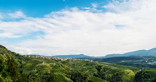 Panorama of Trentino. Italy,26 Septembre 2017,a panorama of the mountains of Trentino, a plantation with vineyards Stock Photos