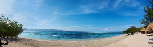 Panorama of tropical beach with blue ocean Stock Image