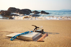 Panorama of tropical beach with old vintage sundial and notebook Stock Image