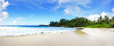 panorama of tropical beach.palms,granite rocks and turquoise water,seychelles 1 royalty free stock photo