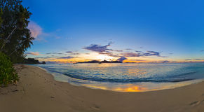 Panorama of tropical beach at sunset Royalty Free Stock Photos