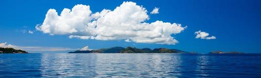 Panorama of tropical islands and big cloud Stock Photos
